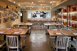 The mishpacha (family) room downstairs at DGS is designed for events and following the action in the kitchen.